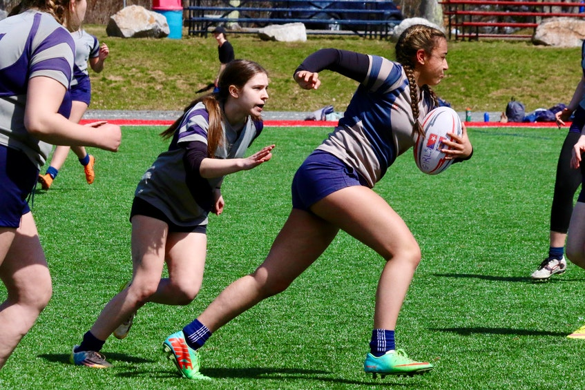 Avon View's Janaya States dashes up the pitch, with teammate Jenny Wile running in support. The AVHS girls' rugby program has won the provincial championship title multiple times in the last decade. - Carole Morris-Underhill