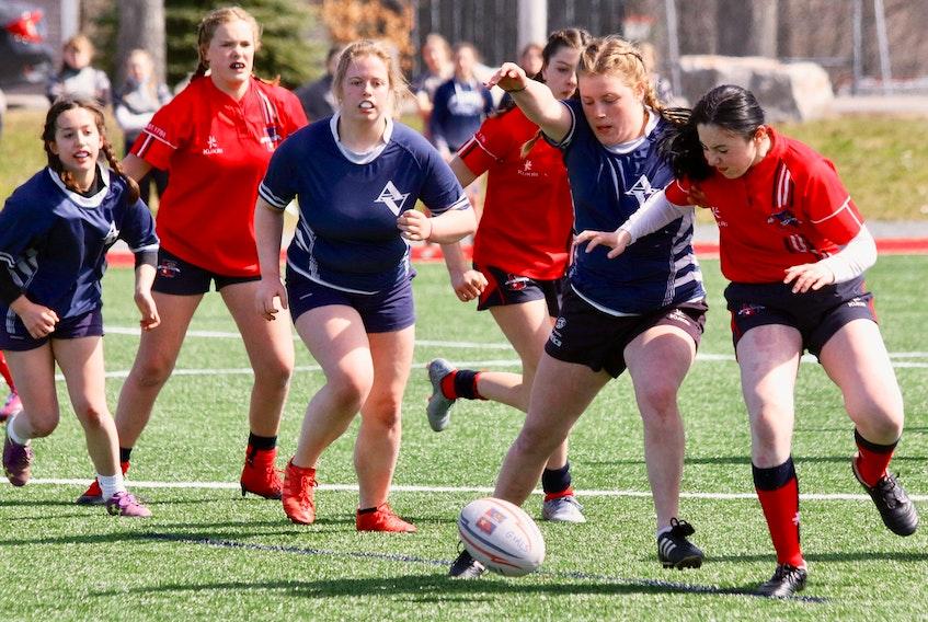 Avon View's Amy Verge and King's-Edgehill's Sofia McSweeney battle to retrieve a wayward rugby ball.