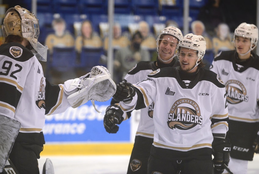 Goalie Colten Ellis, from left, and his Charlottetown Islanders teammates Keiran Gallant, Zac Beauregard and Oscar Plandowski finished the condensed 2020-21 Quebec Major Junior Hockey League in first place overall.