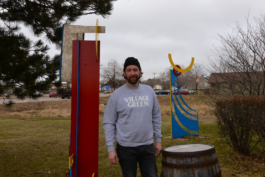 Bryan Carver, owner of the Village Green pub and microbrewery in Cornwall, is going to have a patio made up of picnic tables on the lawn near the large tree this season. - Terrence McEachern