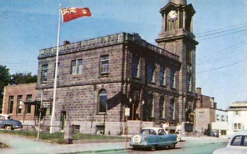 A vintage postcard shows the Dartmouth Post Office in the 1950s, prior to its later expansion and with a clock tower that was later removed. - Color Craft postcard