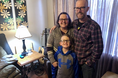 Chris McCormick stands with his wife, Tanya, and their son Calem in the living room of their Sydney home on Tuesday, two months after doctors found an aneurysm on the right side of his brain. NICOLE SULLIVAN/CAPE BRETON POST