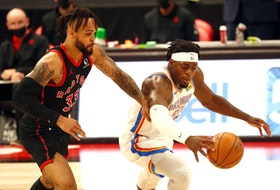 Toronto Raptors guard Gary Trent Jr. and Oklahoma City Thunder forward Luguentz Dort fight for the ball.