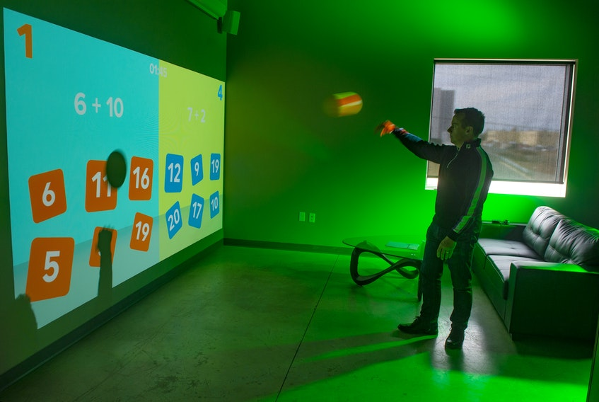 Geoff Baker, president of 3D Audio Visual Solutions in Dartmouth Crossing, gives a demonstration of the Lü Interactive Playground at his company's design studio on Friday, April 16, 2021.