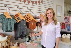Rochelle Simmons, owner of Sawyer + Sunny Boutique, shows off some of the products on offer at the new downtown Sydney shop that is dedicated to mothers and babies. The new store is located on Charlotte Street. DAVID JALA/CAPE BRETON POST