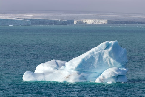 An iceberg floats near Philpots Island in Nunavut. As a northern country, Canada will be among the first to feel the impacts of climate change, says Brian Hodder.