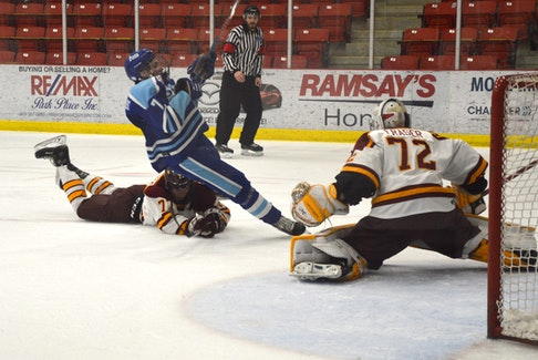 Preston Pattengale of the Sydney Mitsubishi Rush, left, takes down Blake Pilgram-Edwards of the Steele Subaru Majors during Nova Scotia Under-18 Major Hockey League playoff action at the Membertou Sport and Wellness Centre on Saturday. Pattengale was issued a tripping penalty but the Majors didn't score on the power play. Sydney won Game 3, 7-2. JEREMY FRASER • CAPE BRETON POST