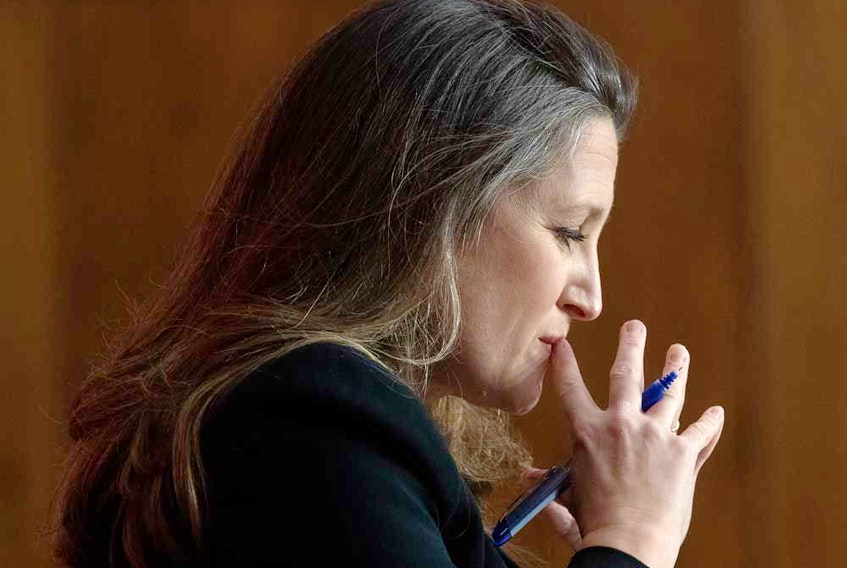 Minister of Finance Chrystia Freeland listens to a question during a news conference on the federal budget on Monday.