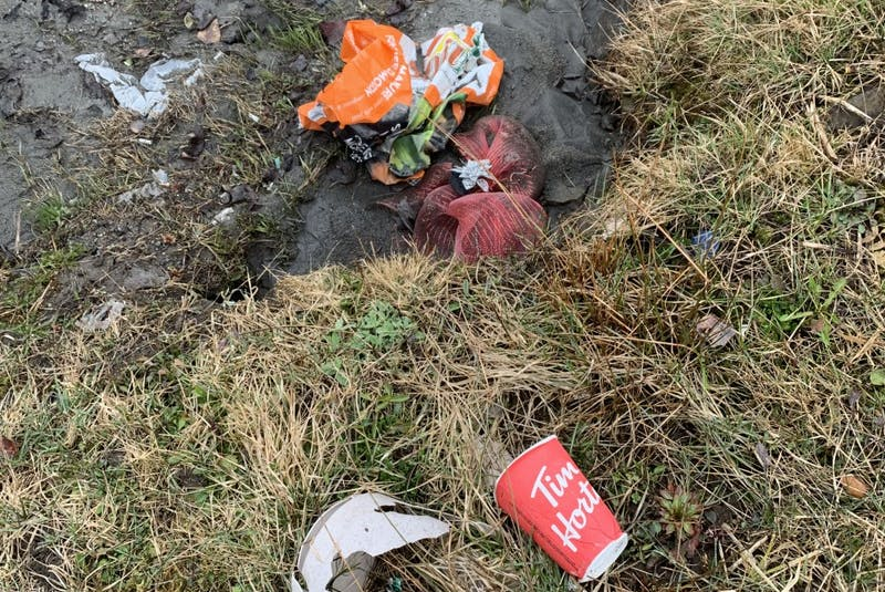 Trash sitting near a stream in Cape Breton. Waste in waterways and streams often ends up in the oceans. JESSICA SMITH/CAPE BRETON POST