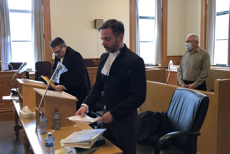 Former Anglican priest Robin Barrett stands in the dock in Courtroom 2 at Newfoundland and Labrador Supreme Court in St. John's Monday, behind his lawyer, Mark Gruchy (left) and prosecutor Shawn Patten. - Tara Bradbury