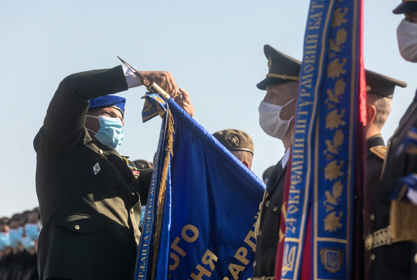 Soldiers take part in an August 2020 ceremonial flag raising at the military airfield in Vasylkiv, Kyiv region.