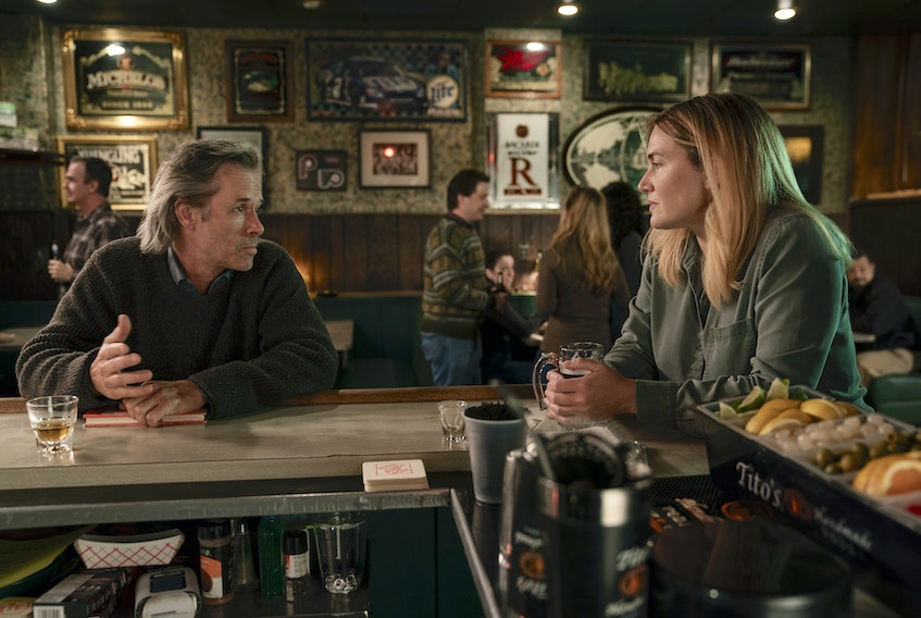 Kate Winslet, right, plays the lead character in Mare of Easttown, which is currently showing on Crave. She's pictured with Guy Pearce in the first episode, which dropped April 18. - Warner Media image