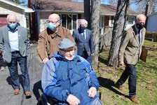 On his 104th birthday, Hormidas Fredette of New Minas is joined by his son, Brian Fredette, Kings County councillor Jim Winsor, Kings South MLA Keith Irving and Kings County Mayor Peter Muttart to watch a parade of well-wishers pass by his home. KIRK STARRATT