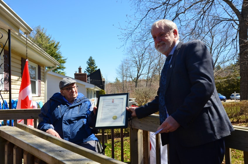 Kings South MLA and Environment and Climate Change Minister Keith Irving, right, presents a provincial plaque to Hormidas Fredette of New Minas in recognition of Fredette's 104th birthday. KIRK STARRATT