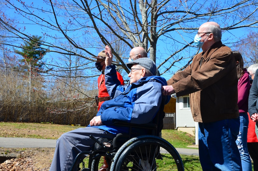 Hormidas Fredette of New Minas waves to well-wishers who formed a parade and drove past his home on April 11 to wish him a happy 104th birthday. KIRK STARRATT