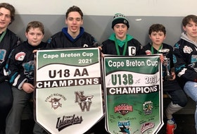 Members of the Crosby and MacNeil family with their Cape Breton Cup championship banners from the 2020-21 season. Both New Waterford families had three sons who captured titles this season at the under-18 'AA' and under-13 'B' divisions. From left, Ethan MacNeil, Cooper Crosby, Parker Crosby, Joe MacNeil, Matt MacNeil and Tyson Crosby. CONTRIBUTED • KEVIN CROSBY
