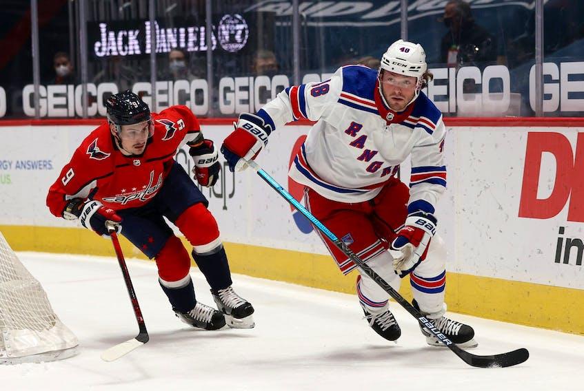 Brendan Lemieux still with the New York Rangers skates past Dmitry Orlov of the Washington Capitals  on March 19, 2021.