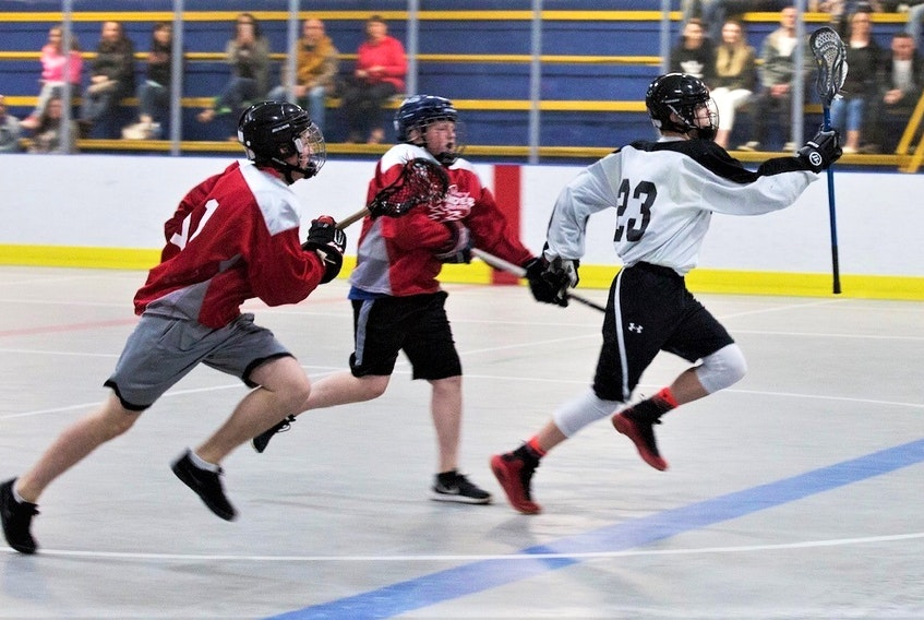 Game action from 2019 between the Truro Bearcats (white jersey) and Valley Thunder, at the Scotia Minor Lacrosse League's U-14 level. Pictured from Truro is Mason McNeil (#23).