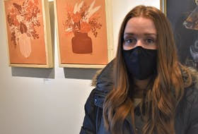 Megan Johnson, an executive member with the Truro Art Society, stands beside her work at the library exhibit.