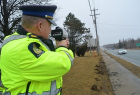 Sgt. Joe Farrell of the Cape Breton Regional Police Service traffic unit points a lidar device at cars travelling on Grand Lake Road. Officers are on the lookout for speeding and aggressive driving offences, which tend to increase as weather gets warmer. CAPE BRETON POST FILE