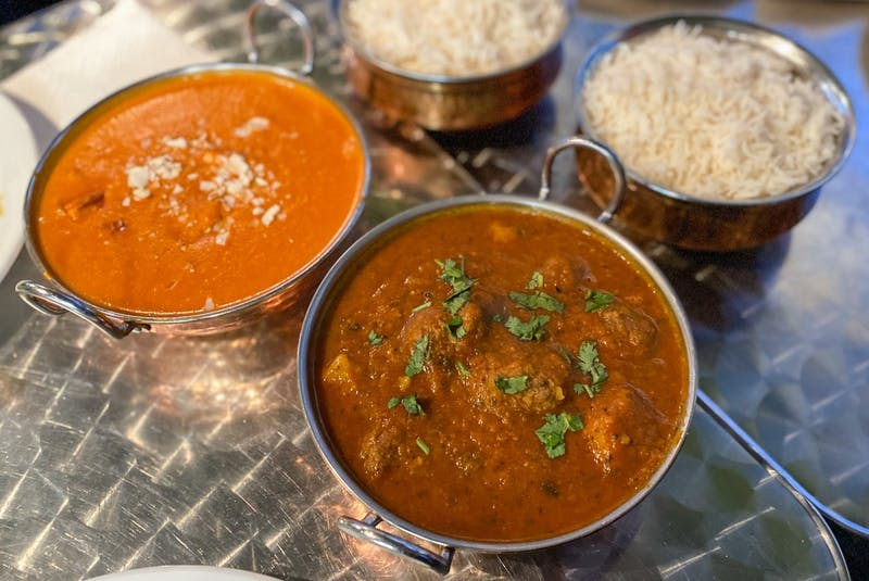 Traditionally-prepared Indian dishes like chicken korma, beef vindaloo and lamb rogan josh are served in metal karahi bowls at the Waldegrave location. - Gabby Peyton