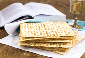 Matzo and wine are ready for a passover celebration. While normal Passover seders involve gathering the Jewish community for prayer, feasting and song, COVID-19 protocols kept people at home in smaller groups this year.