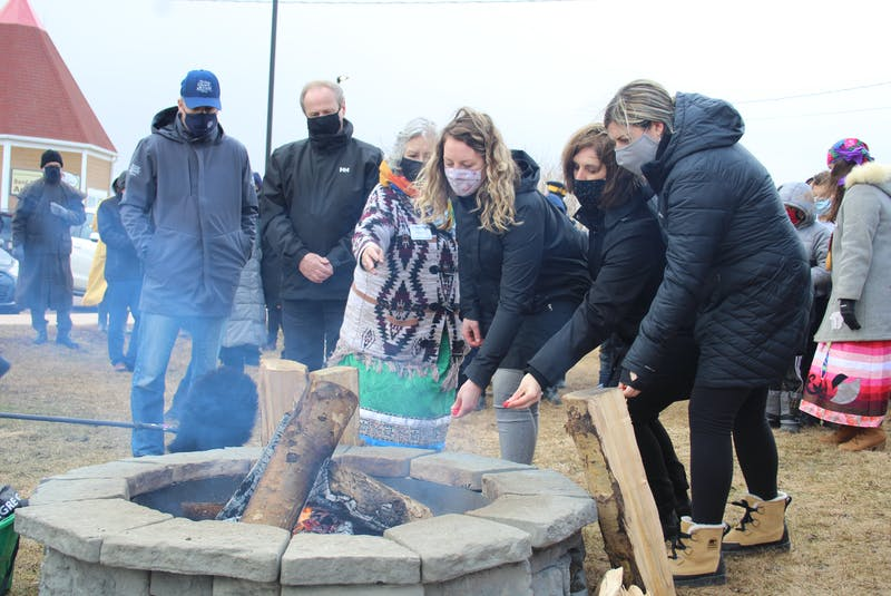 After the walk, participants gathered around a sacred fire. They were given tobacco to carry on the walk, which they tossed into the fire, while praying for help in achieving reconciliation and whatever else came to mind. - Kristin Gardiner