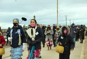 Around 60 to 70 people attended the walk, which started at the top of the causeway and ended at the John J. Sark Memorial School on Lennox Island.