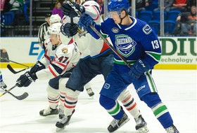Canucks prospect Kole Lind in action last season with the Utica Comets.