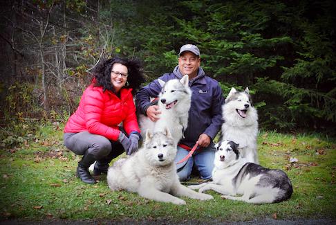 Windsor RCMP Cst. Richard Collins with wife, Deborah and huskies Tazer, Ace, Blaze and Karma. - Photo Courtesy Sherril Inglis Photography.