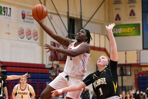 Elizabeth-Ann Iseyemi goes for the hoop in an exhibition game against Dalhousie. - Peter Oleskevich