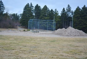 The backstop is all that is left of the old ball field in Bay Roberts at the town's community gardens. The town is converting that land into a new sensory garden and outdoor space. Nicholas Mercer/SaltWire Network