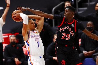 Toronto Raptors forward Chris Boucher defends Oklahoma City Thunder forward Darius Bazley.