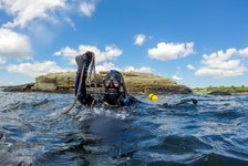 Alexa Goodman, project manager for the Coastal Action group of Nova Scotia, takes a dive for lost fishing gear off Southwest Nova Scotia in 2020.