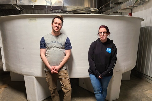 Chris Malanka is Grieg NL's smoltification manager in Marystown. Laura Dwyer is the company's research and development manager.