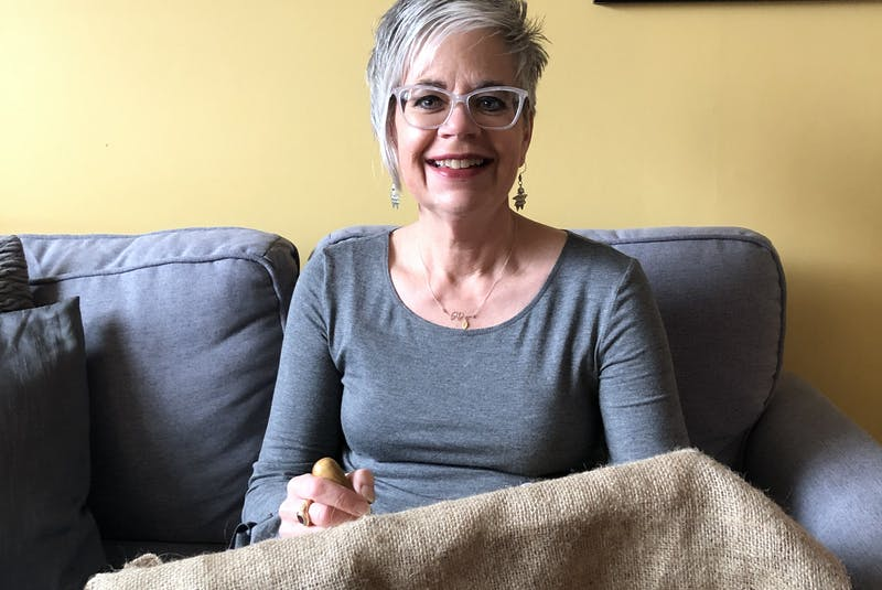 Sonya Corbin Dwyer of Corner Brook enjoys everything about rug hooking, from the smell of the wool, to the colours, creating patterns and bringing them to life on burlap. She recently gifted a piece she created to Gurdeep Pandher of the Yukon that depicts him bhangra dancing. (Teagan Dwyer Photo) - Contributed