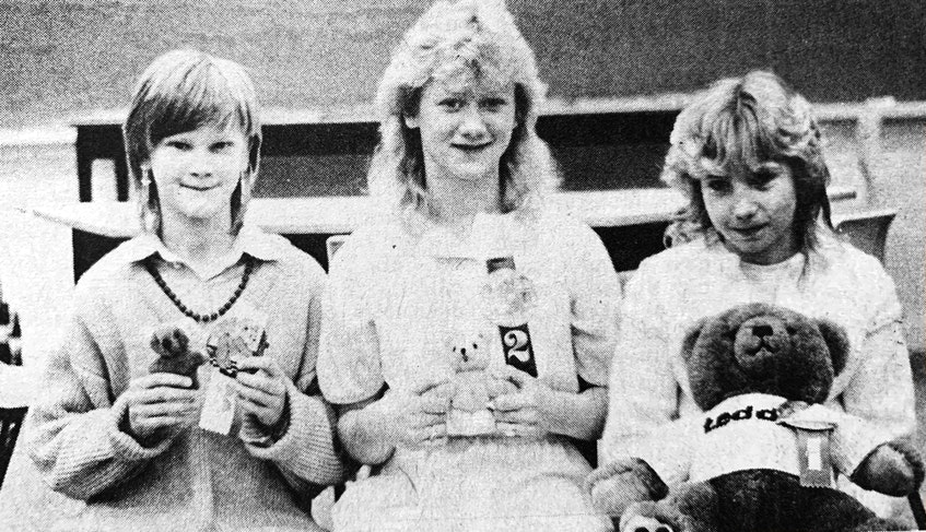 Beverly Woodman, right, won the 1986 Teddy Bear Jamboree logo design competition which would be incorporated into the first annual event. Runners up were Tammy Wentzell, centre, and Sylvia Pulsifer, who came in third place. - File Photo