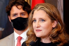 Deputy Prime Minister and Finance Minister Chrystia Freeland speaks to reporters next to Prime Minister Justin Trudeau on Parliament Hill in Ottawa in this file photo. REUTERS