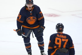 Edmonton Oilers defenceman Ethan Bear (74) celebrates his goal with teammate Connor McDavid (97) against the Montreal Canadiens on Monday, April 19, 2021, in Edmonton.