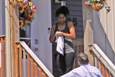FOR LAMBIE STORY: Patricia Downey speaks with reporter Chris Lambie outside her home Tuesday April 20, 2021.
