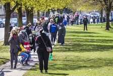 A lineup, that at one point stretched for about 1.5 km, for a Mobile Vaccine Clinic at Parkway Forest Community Centre near Sheppard Ave. E., and Don Mills Rd. in Toronto, on Monday April 19, 2021.