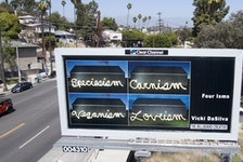"""This is the billboard in Los Angeles that features the work, """"Four Isms"""" by Inverness artist Vicki DaSilva. DaSilva is one of 30 North American artists chosen to have their art featured on billboards in the U.S. city. The barn shown in each of the four photos is located in Mabou. CONTRIBUTED"""