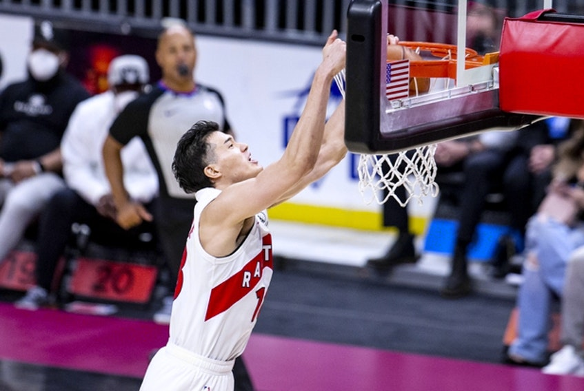 The Raptors' Yuta Watanabe dunks during a game in Cleveland on April 10. For the first time in his career, Watanabe showed up to practice on Tuesday with a standard NBA contract.