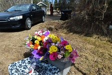 A flower memorial outside the Paterson-Gartner home in Strathcona County, where tax lawyer Greg Gartner killed wife Lois Paterson-Gartner and their 13-year-old daughter Sarah on May 4, 2020. Gartner then took his own life. In March, Gartner's estate filed a lawsuit against Gartner's former colleagues saying they are withholding money. The defendants deny any wrongdoing.