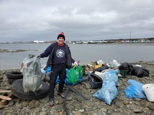 "Meet Luke MacDonald, referred to by his ocean warrior friends as a ""superstar cleaner."" This photo was taken at the Scotian Shores Lawlor Island Clean Up, where the team removed over 4000 lbs (1,800 kgs) of shoreline debris! Thank you for doing what you do for our planet. - Contributed."