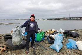 "Meet Luke MacDonald, referred to by his ocean warrior friends as a ""superstar cleaner.""  This photo was taken at the Scotian Shores Lawlor Island Clean Up, where the team removed over 4000 lbs (1,800 kgs) of shoreline debris. Thank you for doing what you do for our planet!"