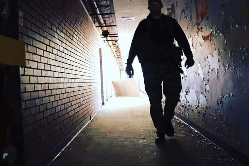 An airsoft player walks down one of the halls while playing at the Yarmouth Airsoft indoor/outdoor playing field at the  former Shelburne Youth Centre in Sandy Point. Contributed   - Saltwire network