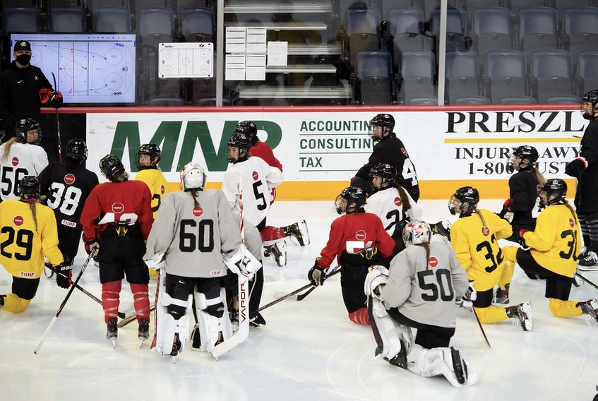 Team Canada players listen to head coach Troy Ryan during practice at the team's selection camp Monday at Scotiabank Centre in Halifax. The IIHF women's world championship, which was scheduled for Halifax and Truro next month, was cancelled on Wednesday. - Hockey Canada Images