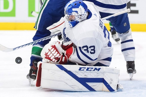 Maple Leafs goalie David Rittich makes a save against the Canucks during the second period of an NHL game in Vancouver, Tuesday, April 20, 2021.