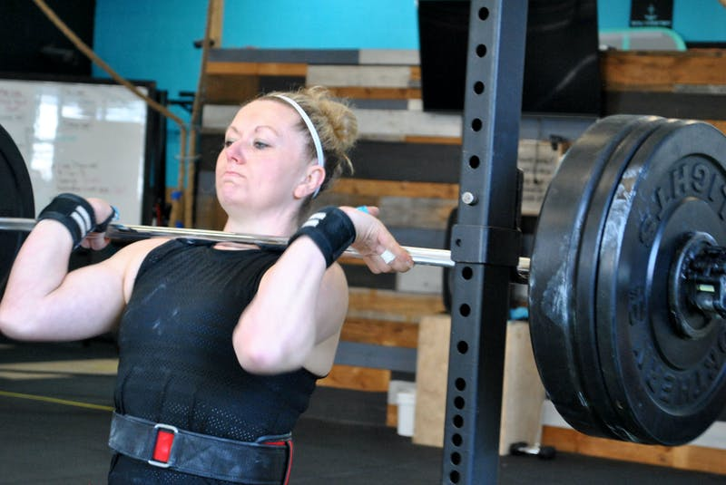 Riley Foley does a barbell front squat lift as one of her workouts for the CrossFit Games quarterfinals.  She lifted 185 lbs for 4 reps. KATHY JOHNSON - Saltwire network